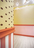 Interior with yellow wallpaper in brown polka yellow dots. Interior with yellow wallpaper in brown polka dots above the skirting, and cream-red striped wallpaper royalty free stock photo