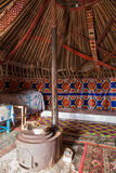 Interior of yurt. Interior decoration of the yurt. Living room with stove Stock Photos
