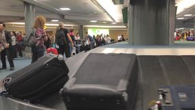Interior YVR Airport baggage claim with luggage spinning stock video footage