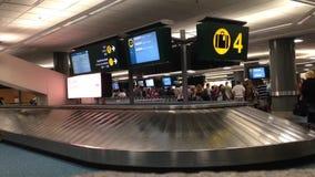 Interior YVR Airport baggage claim with luggage spinning around conveyor. stock video
