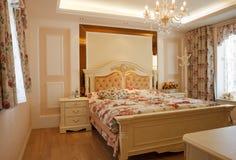 Interiore costoso di lusso della camera da letto Fotografia Stock
