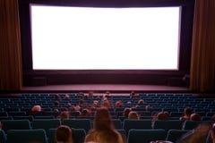 Interiore del cinematografo con la gente Immagini Stock Libere da Diritti