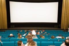 Interiore del cinematografo con la gente Fotografia Stock