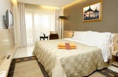 Interiore della camera da letto dell'hotel Fotografia Stock