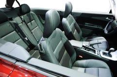 Interiore rosso dell'automobile Fotografie Stock