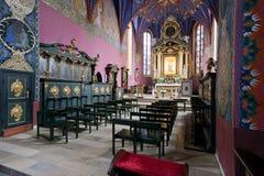 Interioren av en gotisk kyrka, Polen. Royaltyfri Bild