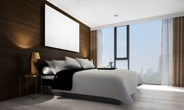 The interiors design idea of bedroom and concrete wall and cityscape view and wood wall and picture frame. Thre modern bedroom interior design concept decoration Royalty Free Stock Image
