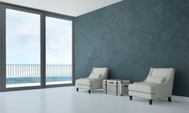 The interiors design idea of luxury lounge chair and concrete blue wall background and sea view. 3d rendering interior design concept idea of lounge and living Stock Photos