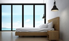The interiors design idea of minimal bedroom and concrete wall and sea view. 3d rendering interior design concept idea of bedroom Royalty Free Stock Images