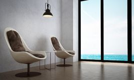 The interiors design of minimal lounge chairs and living room and sea view. 3d rendering interior design concept of living room Royalty Free Stock Photography