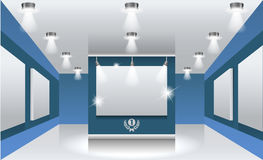 Interiors. Exhibition hall with white frames on the wall, illuminated by floodlights. Part of set. Vector interiors. Exhibition hall with white frames on the Royalty Free Stock Images