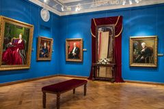 Interiors of the Gallery of fine arts Shilov Moscow Russia. Beautiful interiors of the Gallery of fine art Shilov Moscow Russia with portraits on the walls royalty free stock photos