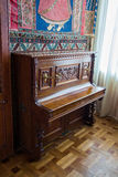 Interiors of halls in Vorontsov Palace in Alupka. An old piano in Vorontsov Palace in Alupka. The palace is built in 1848 stock photo