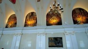 Interiors of Jasna Gora Monastery, Czenstochowa, Poland. CZESTOCHOWA, POLAND - JUNE 12, 2018: Historic Knights Hall of Jasna Gora Monastery with colorful banners stock video