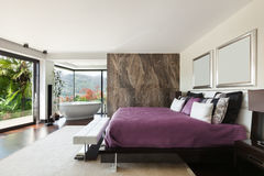Interiors, luxury bedroom. Architecture, modern house, beautiful interiors, wide bedroom Stock Images