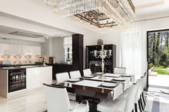 Interiors, luxury dining room. Architecture, modern house, beautiful interiors, dining room Stock Photography
