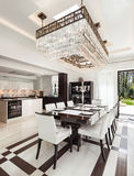 Interiors, luxury dining room. Architecture, modern house, beautiful interiors, dining room Royalty Free Stock Photo
