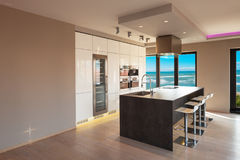 Interiors of a modern apartment, kitchen with sea view Royalty Free Stock Image