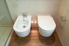 Interiors, modern toilet. Interior modern house, bathroom, toilet and bidet view stock photos