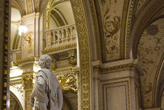 Interiors of the Vienna Opera House. VIENNA, AUSTRIA - JANUARY 2 2016: Interiors of the Vienna Opera House, with a classic sculpture in the foreground Royalty Free Stock Photos