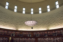 Interiour of large, circular library. Stockholm city library with a large amount of rows of bookshelves and a huge ceiling lamp stock photo