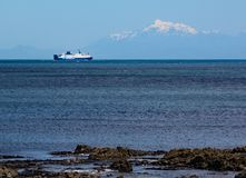 Interislander ferry on the Cook Strait sails towards the South Island. The snow capped mountains can be seen in the background royalty free stock images
