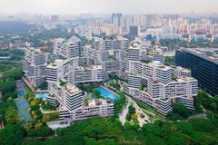 The Interlace apartments in Singapore city and skyscrapers. Buildings. Modern architecture background. Aerial view stock photo