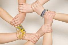 Interlaced children hands. 7 children hands make a circle stock photography