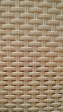 Interlaced solid surface, imitation of bamboo wicker. Background. Close-up royalty free stock photos