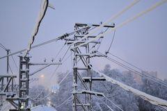 Interlacing electrical wires in the snow. Early morning. Russia.  royalty free stock photography