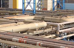 Interlacing of huge pipes in a factory stock photo