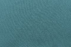 Interlacing texture fabric of indigo color. Abstract interlacing texture of textile fabric of indigo color for empty and pure backgrounds royalty free stock photos