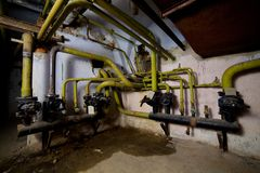 Interlacing of water pipes in the basement, building communicati Royalty Free Stock Photos