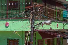 Interlacing of wires. Urban indian electricity pole. Royalty Free Stock Photo