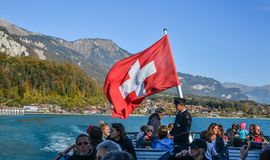 Swiss flag on tourist ferry royalty free stock photo