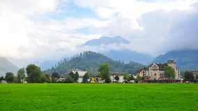 Interlaken town surrounded by famous mountain peaks Stock Image