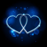 Interlocked glowing hearts background blue Stock Photo