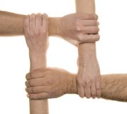 Interlocked hands. Time work - cooperation stock photos