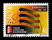 Interlocking Arrows, 25th Anniv. of Union Haddiema Maghqudin serie, circa 1991. MOSCOW, RUSSIA - OCTOBER 3, 2017: A stamp printed in Malta shows Interlocking Stock Photo