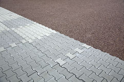 Interlocking brick flooring. Pattern of interlocking bricks on a floor Royalty Free Stock Photography