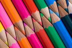 Interlocking Colored Pencils. Tips of sharpened colored pencils, artistically arranged with points closely aligned in an interlocking, diagonal display of color Royalty Free Stock Photo