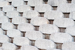 Interlocking concrete retaining wall. Close up patterns and textures of curved interlocking concrete retaining wall bricks Royalty Free Stock Photo