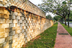 Interlocking designed retaining wall to manage earth erosion. And  landscaping Royalty Free Stock Image