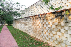 Interlocking designed retaining wall to manage earth erosion. And  landscaping Royalty Free Stock Images