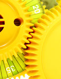Interlocking gear cogs close up. An image of two interlocked cogs taken at close range.  Bright colors and vertical format. Concept image for team working and Stock Images
