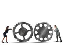 Interlocking gears. Businesspeople working together for perfect interlocking gears Stock Photo