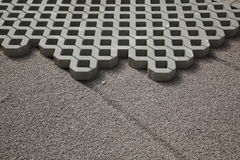 Interlocking paving blocks. Interlocking concrete paving blocks on level sand Stock Photo
