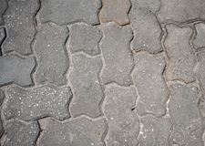 Interlocking paving with gray and white concrete blocks. Stones of the pavement of an urban street Stock Photography