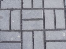 Interlocking paving with gray and white concrete blocks Concrete products Construction industry Paved ground.  Royalty Free Stock Photos