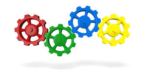 Cog wheels. Interlocking red, green, blue and yellow  cog wheels isolated on white background Stock Photo